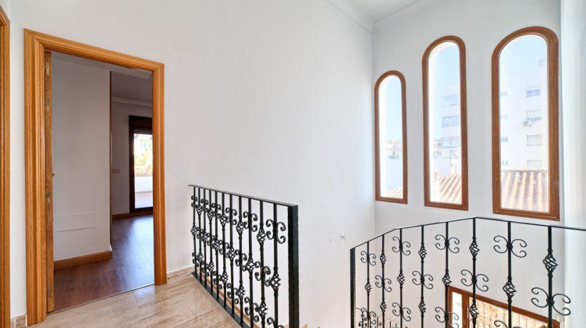 Semi detached villa in Marbella centre - image 9-hallway-upstairs-835x467 on https://www.laconchaliving.com